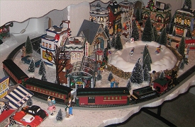 The Garafano family's Christmas Village consists mostly of Dept. 56 buildings and accessories.  It also includes the On30  train that Bachmann made to go with Dept. 56 houses. Click to see the whole photo.
