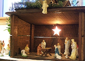 My parents' Nativity set was almost entirely dime-store plaster figures in a stable my Uncle Carl built for them when they were newly-weds. Click for bigger photo.